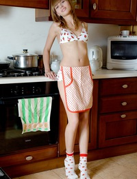 Horny cooking teenager caresses her drenched wet cooter