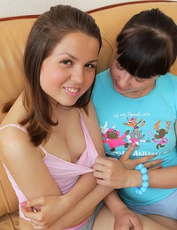 Horny teen chicks petting each others snatch on a couch