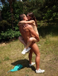 A fellow pounding her tight teenage snatch in the grass