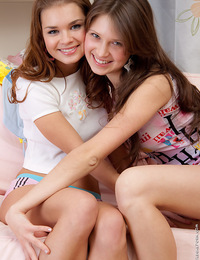 Teasing lesbian teens playing with a strapon dildo