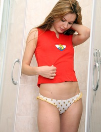 A pretty stunning teenager showering her slippery snatch