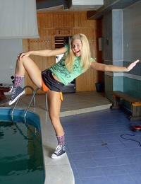 Teenage blonde chick enjoys playing with a blow up ball