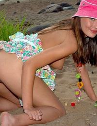 A blistering hot teenage girl pleasuring on a public beach