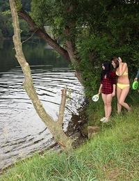 Outdoor camping teenagers playing with their wet cooters