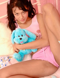 Adorable schoolgirl strokes her clit with a large dildo