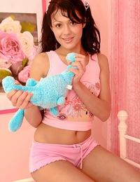Adorable teenage beauty pleasures her moist naked snatch