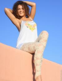 Booty teen Klara posing naked on the roof