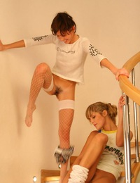 Two young charming girlfriends posing nude on camera